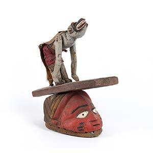 A PAINTED WOOD HELMET MASK Yoruba48 cm high ...