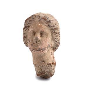 Testina in terracotta del tipo Tanagra IV - ...