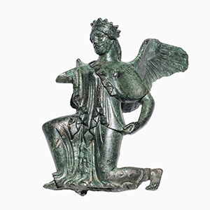 Bronze winged Goddess Nike in archaic style ...