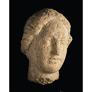 An outstanding Etruscan travertine female ...