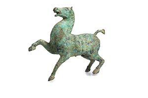 AN ARCHAIC BRONZE MODEL OF A HORSE China, ...