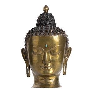 TESTA DI BUDDHA IN BRONZO DORATO Tibet, XX ...
