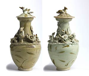 A PAIR OF QINGBAI-GLAZED URNS AND COVER WITH ...