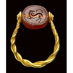 An etruscan carnelian scarab mounted in an ...