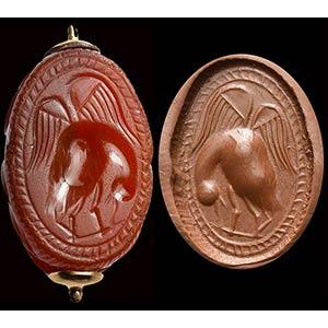 An etruscan carnelian scarab intaglio. ...