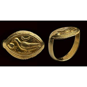 An etruscan gold ring with engraved ovoid ...