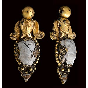 An etruscan gold pendant with burnt stone ...