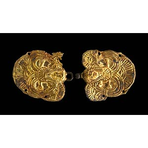A pair of etruscan embossed gold plaques. ...