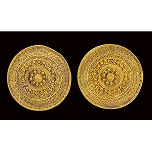 A pair of etruscan gold disc ear-stud. diam. ...