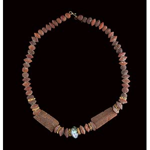 An etruscan amber and glass necklace. total ...