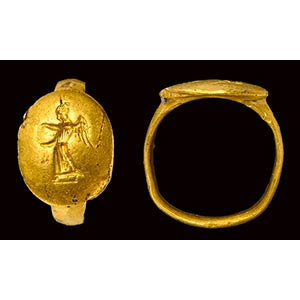 A classical greek massive gold ring with ...