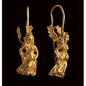 A greek gold hellenistic earring. Winged ...