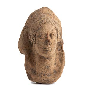 Etruscan terracotta votive head of a young, ...