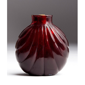 Carved red glass snuff bottle; XX Century; ...