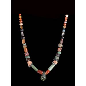 A GLASS, STONE AND POTTERY BEADS NECKLACE ...