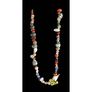 A GLASS AND STONE BEADS NECKLACE56 ...