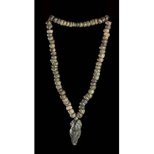 A STONE BEADS NECKLACE WITH ZOOMORPHIC ...